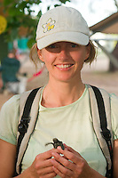 Sydneysider and volunteer ecotourist Louise Southerden holds a baby turtle which she will release on a remote beach on the west coast of Cape York in far northern Australia.