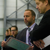 Todd Johnson, Head coach (4th Season) of the Regina Cougars men's hockey team in action during the Men's Hockey Home Game on November 19 at Co-operators arena. Credit: Arthur Ward/Arthur Images