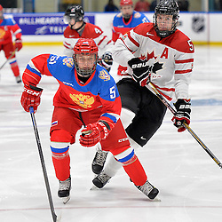 WHITBY, - Dec 14, 2015 -  Game #4 - Russia vs. Canada East at the 2015 World Junior A Challenge at the Iroquois Park Recreation Complex, ON. Nikolay Kovalenko #51 of Team Russia and Adam Smith #5 of Team Canada East follow the play during the first period.<br /> (Photo: Shawn Muir / OJHL Images)