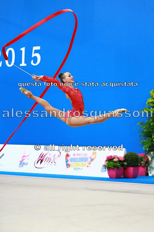 Rizatdinova Anna during qualifying at ribbon in Pesaro World Cup at Adriatic Arena on April 11, 2015. Anna was born July 16, 1993 in Simferopol, she is a Ukrainian individual rhythmic gymnast.