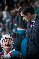 KELOWNA, CANADA - MARCH 31: Assistant coach Travis Crickard stands on the bench and speaks to Carsen Twarynski #18 of the Kelowna Rockets on March 31, 2017 at Prospera Place in Kelowna, British Columbia, Canada.  (Photo by Marissa Baecker/Shoot the Breeze)  *** Local Caption ***