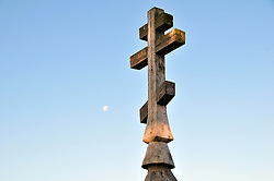 A cross marks a family grave on the shores of Kizhi Island, in Russia's Lake Onega. The island is home to the world-famous Transfiguration Church, a timbered marvel with 22 onion domes built without a single nail. Over the years a number of other traditional wooden structures have been moved from Karelia to preserve them, and the island is now a UNESCO World Heritage site.