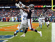 Detroit Lions cornerback Nevin Lawson (24) leaps and breaks up a pass intended for Chicago Bears rookie wide receiver Cameron Meredith (81) during the NFL week 17 regular season football game against the Chicago Bears on Sunday, Jan. 3, 2016 in Chicago. The deflected pass was intercepted by Detroit Lions strong safety James Ihedigbo (32). The Lions won the game 24-20. (©Paul Anthony Spinelli)