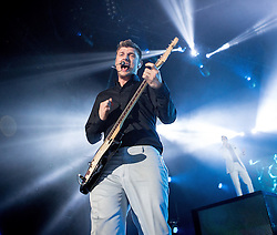 © Licensed to London News Pictures . 05/04/2014 . Manchester , UK . Nick Carter on guitar . The Backstreet Boys play at the Phones4U Arena in Manchester this evening (Saturday 5th April 2014) . Photo credit : Joel Goodman/LNP