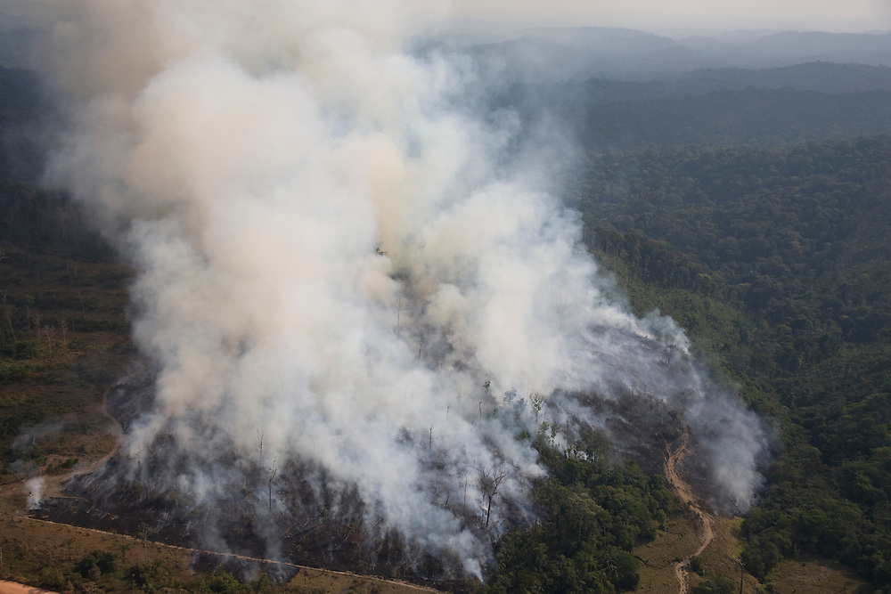 Para State, Brazil. August 27th 2007. Flight from Itaituba to Alta Floresta (Brazilian Amazon). Aerial view of the rainforest during the burning season were big sections are set on fire by farmers to be cleared for soy farming or cattle grazing.