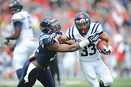 Nathan Vanderburg (33) is tackled by Temario Strong (33) during Mississippi's Grove Bowl controlled scrimmage at Vaught-Hemingway Stadium in Oxford, Miss. on Saturday, April 5, 2014. (AP Photo/Oxford Eagle, Bruce Newman)