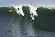 Greg Long and Russel Smith battle it out in the first heat of the 2008 Mavericks Surf Contest on January 12 2008