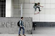 Kids practice their skateboard moves outside the Museum of Modern Art in Barcelona, November 2005