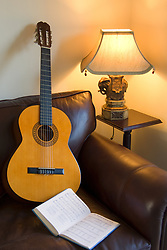 July 21, 2019 - Guitar And Book Of Music On Sofa In Living Room (Credit Image: © John Short/Design Pics via ZUMA Wire)