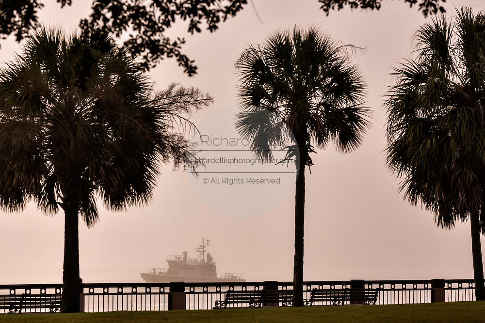 A boat shrouded in the fog along Waterfront Park in the French Quarter of historic Charleston, SC.