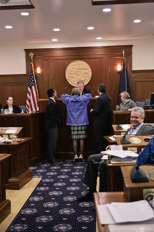 Minority Leader Beth Kerttula (D) (center), Chris Tuck (D) (right), and Scott Kawasaki (D) (left), confer with Speaker of the House Mike Chenault (R) in the Alaska State House of Representatives.