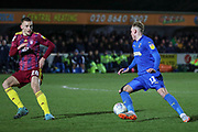 AFC Wimbledon midfielder Mitchell (Mitch) Pinnock (11) dribbling during the EFL Sky Bet League 1 match between AFC Wimbledon and Ipswich Town at the Cherry Red Records Stadium, Kingston, England on 11 February 2020.