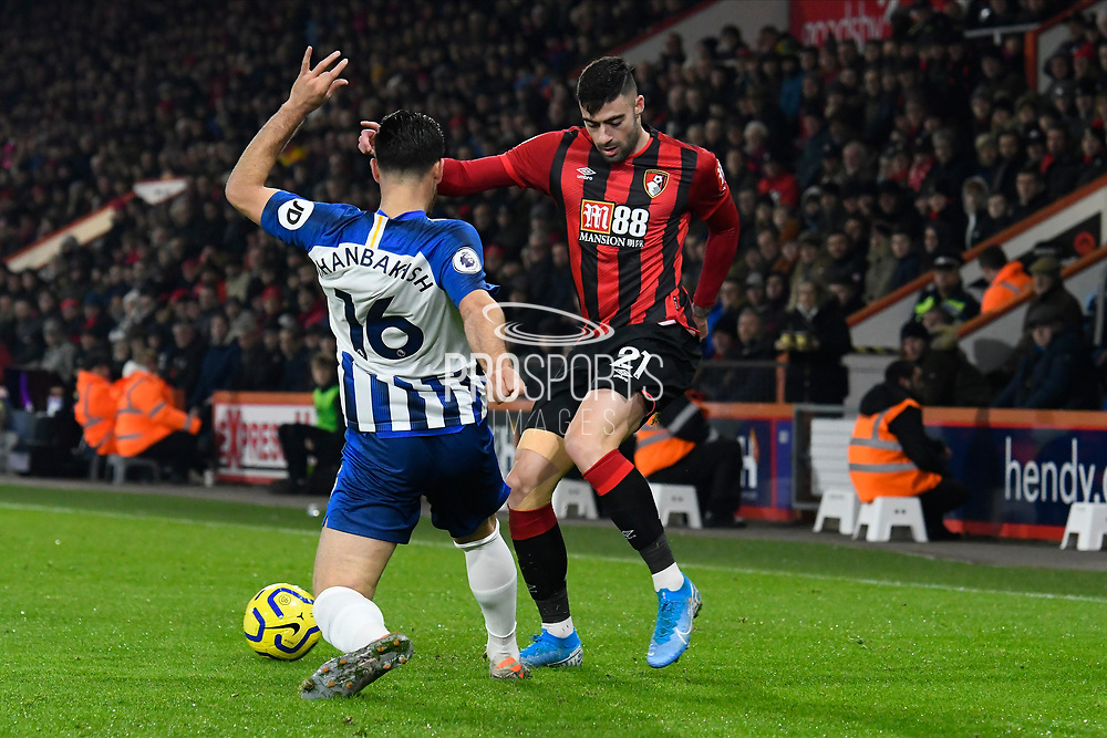 Diego Rico (21) of AFC Bournemouth is challenged by Alireza Jahanbakhsh (16) of Brighton and Hove Albion during the Premier League match between Bournemouth and Brighton and Hove Albion at the Vitality Stadium, Bournemouth, England on 21 January 2020.