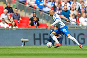 Tranmere Rovers defender Jake Caprice (14) heads upfield during the EFL Sky Bet League 2 Play Off Final match between Newport County and Tranmere Rovers at Wembley Stadium, London, England on 25 May 2019.