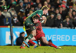 Scarlets winger, Harry Robinson tackles Leicester Tigers full back, Mathew Tait - Photo mandatory by-line: Dougie Allward/JMP - Mobile: 07966 386802 - 16/01/2015 - SPORT - Rugby - Leicester - Welford Road - Leicester Tigers v Scarlets - European Rugby Champions Cup