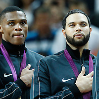12 August 2012: USA Russell Westbrook and Deron Williams stand during the National Anthem following 107-100 Team USA victory over Team Spain, during the men's Gold Medal Game, at the North Greenwich Arena, in London, Great Britain.