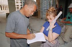 Civil engineers in discussion on building site in Havana; Cuba; working on restoration of the Fine Art Museum  Museo de Bellas Artes,
