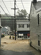 Ellicott City, Maryland - May 27, 2018: First Responders wade through knee deep torrents to rescue people in Historic Ellicott City.<br /> <br /> Historic Ellicott City Maryland was destroyed by floodwaters Sunday May 27, 2018 -- the same day of Kristen Rigney and Craig Cymbor's wedding at Main Street Ballroom in Ellicott City. Their wedding venue flooded minutes before their ceremony was scheduled and the entire wedding party fled to La Palapa, the Mexican food restaurant upstairs, where Craig and Kristen said their vows. Instead of eating, drinking and dancing, the wedding party, watched cars get swept away. <br /> CREDIT: Matt Roth