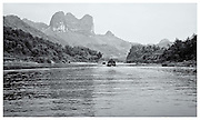boats of River Li, Guangxi provence, China.