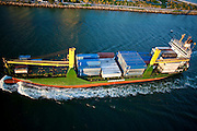 Aerial view of container ship entering channel at Government Cut, Miami, Fl