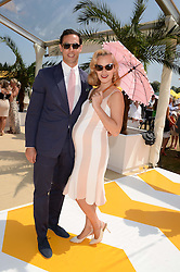 MAXIM CREWE and his wife CHARLOTTE DELLAL at the Veuve Clicquot Gold Cup, Cowdray Park, Midhurst, West Sussex on 21st July 2013.