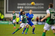 Ryan Jack (#8) of Rangers FC and Stephane Omeonga (#40) of Hibernan FC tussle for the ball during the Ladbrokes Scottish Premiership match between Hibernian and Rangers at Easter Road, Edinburgh, Scotland on 8 March 2019.
