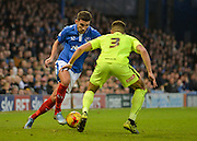 Portsmouth striker Gareth Evans takes on Hartlepool United Defender Jake Carroll during the Sky Bet League 2 match between Portsmouth and Hartlepool United at Fratton Park, Portsmouth, England on 12 December 2015. Photo by Adam Rivers.