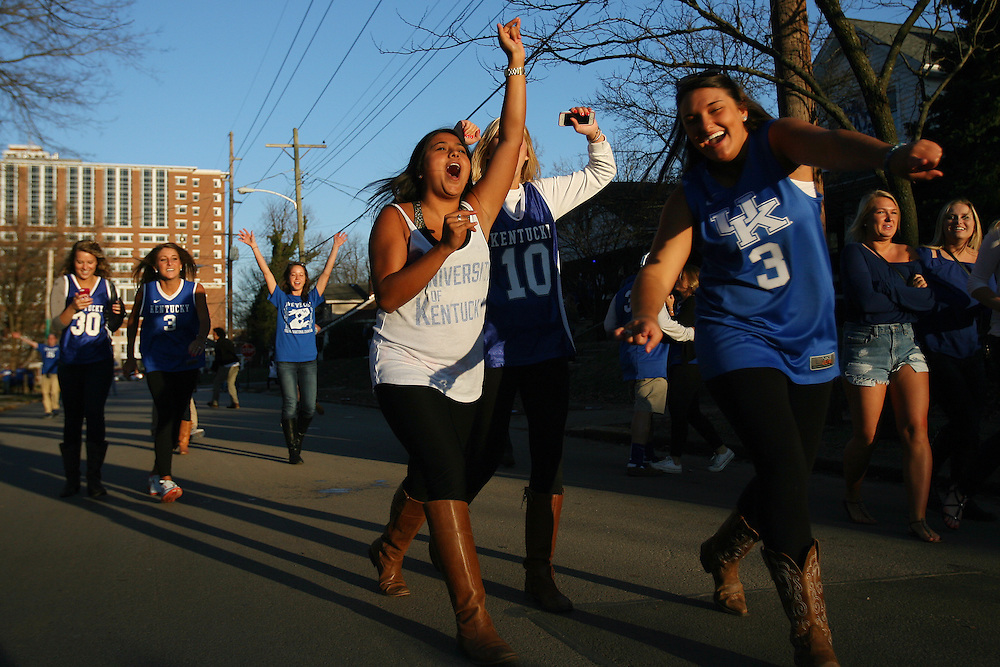 The University of Kentucky has a long history of a tradition of excellence in their men's basketball program. And while things have remained much the same on the court throughout the years, off the court students have adopted new traditions in recent years. The newest of these traditions is the flocking of students to State Street as the celebrations of this party hub live and die by the success of the men's basketball team.<br /> <br /> A 2-block stretch of road just on the outskirts of campus, State Street and adjacent areas have provided a space for students to cheer on the Wildcats. In recent years, following the Wildcats' Sweet 16, Elite 8 and Final Four match-ups students have flooded the street with chants, dancing, drinking and fireworks. <br /> <br /> Some students have taken it upon themselves to engage in egregious activities such as the burning of couches, illegal drug use, and removal of stops signs. With a watchful eye Lexington and UK police line the rows of houses, intervening in situations when they are called upon to protect the safety of UK students and fans in attendance.