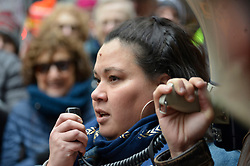 Erika Almirón, executive director of Juntos, speaks during a Presidents Day protest rally, at City Hall, on Monday. (Bastiaan Slabbers for WHYY)