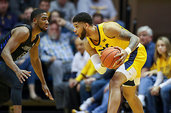 Nov 9, 2018; Morgantown, WV, USA; West Virginia Mountaineers forward Esa Ahmad (23) holds the ball while defended by Buffalo Bulls guard CJ Massinburg (5) during the first half at WVU Coliseum. Mandatory Credit: Ben Queen-USA TODAY Sports