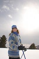 Mature woman skiing in field half-length