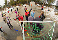 """Matthew and Eason with an assist and a score during """"parking lot hockey"""" with the Meredith Parks and Recreation day campers on Thursday.  Karen Bobotas/ for the Laconia Daily Sun"""