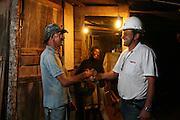 Santos Dumont_MG, Brasil...Funcionario cumprimentando um homem beneficiado da eletrificacao rural...A employee greeting man benefited from rural electrification...Foto: LEO DRUMOND / NITRO