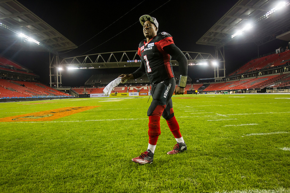 Ottawa quarterback Henry Burris walks across the field following the Redblacks win in the 104th Grey Cup Final game against the Calgary Stampeders in Toronto Ontario, Monday,  November 28, 2016.  (CFL PHOTO - Geoff Robins)