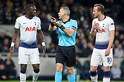Referee Bjorn Kuipers from Holland (NED) gives a penalty and Moussa Sissoko midfielder of Tottenham Hotspur (17) and Harry Kane forward of Tottenham Hotspur appeal during the Champions League Quarter-Final 1st leg between Tottenham Hotspur and Manchester City at Tottenham Hotspur Stadium, London, United Kingdom on 9 April 2019.
