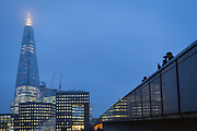 The Shard skyscraper and pedestrians on London Bridge on a winter's afternoon, on 23rd November 2018, in London, England.