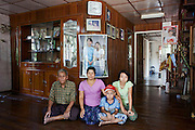 A family that supports the National League for Democracy (NLD). From left to right: Usan, Daw San San Tin, Pyae Phyu Hlaing, Su Thin Zar Hliang. During the campaign period the home of Daw San San Tin (woman on right with Aung San Suu Kyi) in picture was designated as the home in which Suu Kyi would stay overnight. However due to being unwell she could not stay there as planned. The party won with a landslide victory of 95% and this home is in Suu Kyi's constituency. Kawmhu, Myanmar. 2012