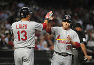 Apr. 13 2011; Phoenix, AZ, USA; St. Louis Cardinals short stop Ryan Theriot (3) is congratulated by teammate Gerald Laird (13) after scoring during a game against the Arizona Diamondbacks at Chase Field. The Cardinals defeated the Diamondbacks 15 -5. Mandatory Credit: Jennifer Stewart-US PRESSWIRE..