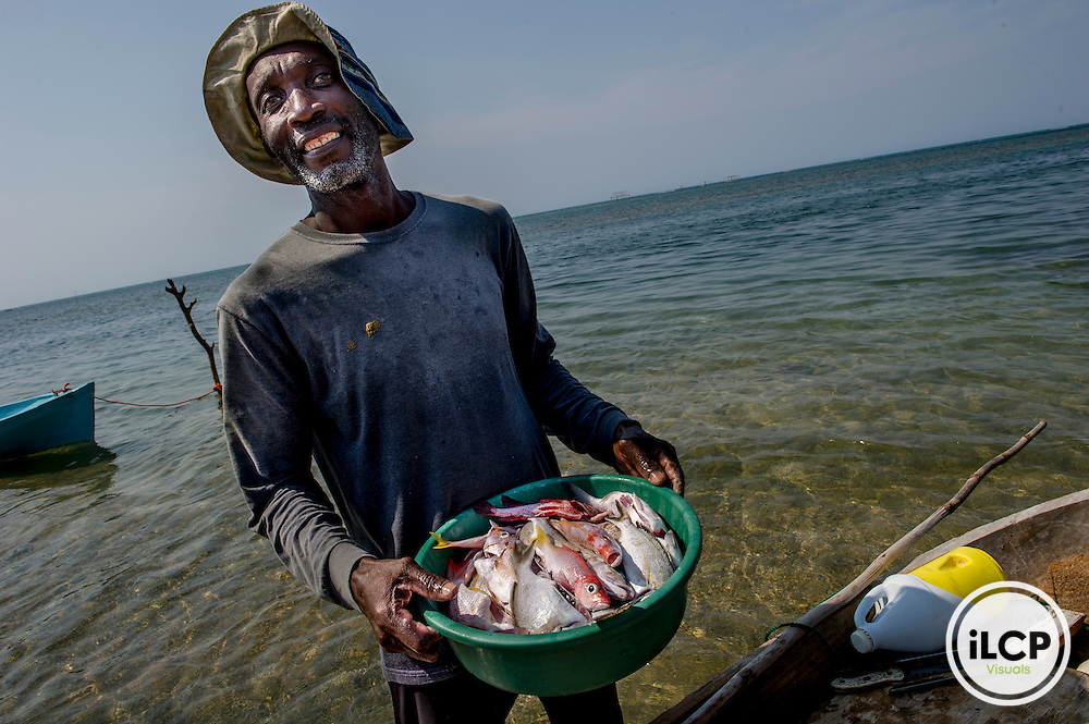 Roatan, one of the Bay Islands off the coast of Honduras has a fair tourist trade.  Also many retirees from the US settle there, the bulk of the citizens speak English.<br />  A Garifuna fisherman, Raul,  shows off his catch.
