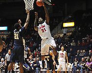 """Ole Miss' Murphy Holloway (31) shoots by East Tennessee State's John Walton (21) at the C.M. """"Tad"""" Smith Coliseum in Oxford, Miss. on Saturday, December 14, 2012. Mississippi won 77-55 to improve to 7-1. (AP Photo/Oxford Eagle, Bruce Newman).."""