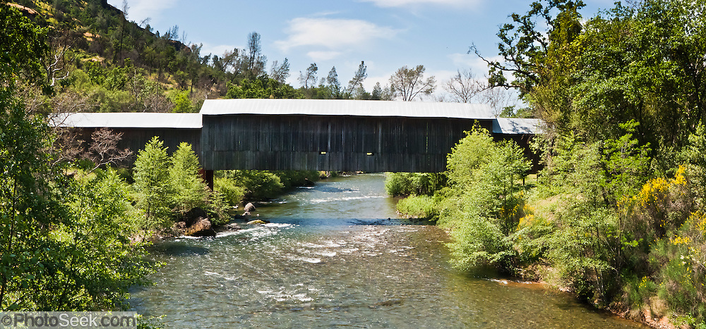 Honey Run Covered Bridge was built in 1894 halfway between Chico and Paradise in Butte County, California, USA. Butte Creek (93 miles long) flows through a scenic volcanic canyon in Butte County, California, USA. Chinook salmon and steelhead runs have been restored to the stream. Panorama stitched from 3 overlapping photos.