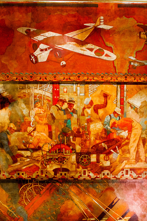 This section of the huge &quot;Transport and Human Endeavor&quot; mural on the ceiling of the Chrylser Building's main lobby depicts scenes of heroic industrialism and early 20th Century transportation including aircraft of the period.<br />