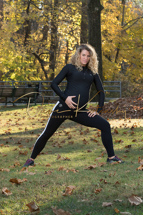 Pregnant trainer poses for a portrait session at 7 months