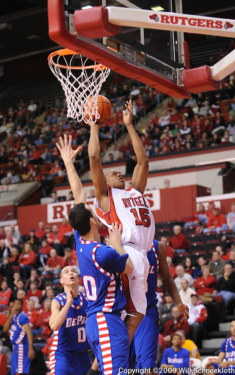 Jan 31, 2009; Piscataway, NJ, USA; Rutgers forward J.R. Inman (15) puts up a shot over DePaul guard Will Walker (30) during the first half of Rutgers' 75-56 victory over DePaul in NCAA college basketball at the Louis Brown Athletic Center