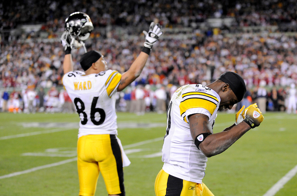 TAMPA, FL - FEBRUARY 01: Wide receiver Santonio Holmes #10 and Wide receiver Hines Ward #86 of the Pittsburgh Steelers celebrate after Holmes go ahead touchdown catch in the 4th quarter drops against the Arizona Cardinals during Super Bowl XLIII on February 1, 2009 at Raymond James Stadium in Tampa, Florida. The Steelers defeated the Cardinals 27 to 23. (Photo by Rob Tringali) *** Local Caption *** Santonio Holmes;Hines Ward