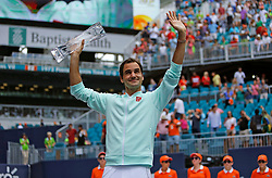 Roger Federer, of Switzerland, celebrates with the trophy after defeating John Isner, of the United States, 6-1, 6-4 during the final of the Miami Open tennis tournament at Hard Rock Stadium on Sunday, March 31, 2019, in Miami Gardens, Fla. Photo by David Santiago/Miami Herald/TNS/ABACARESS.COM
