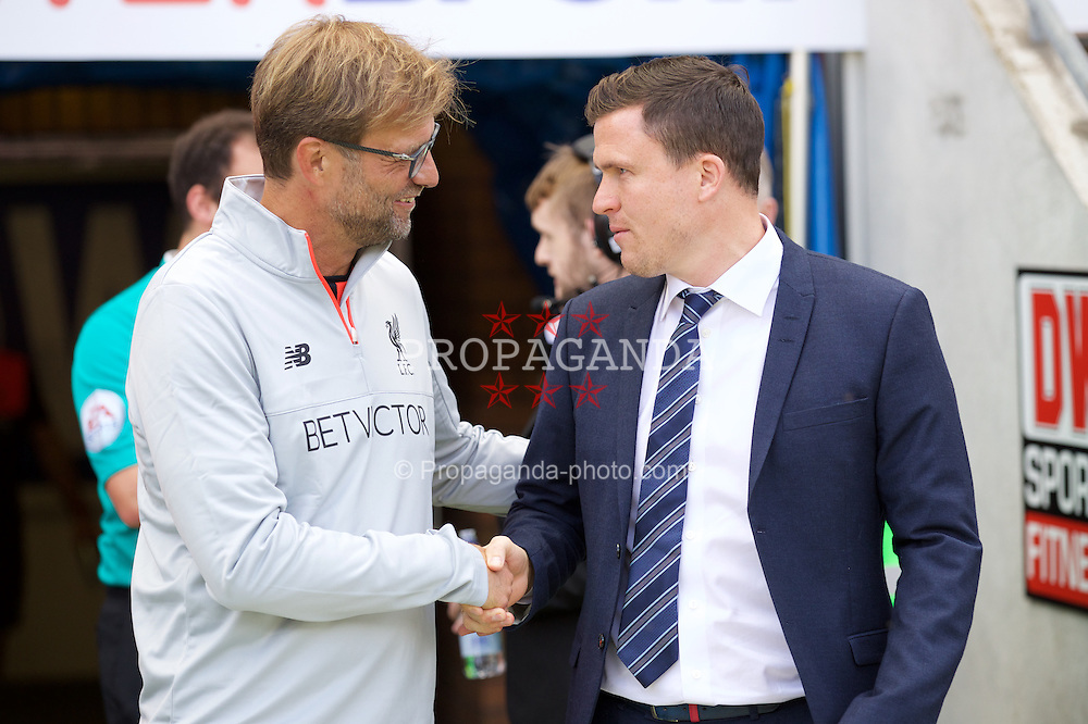 WIGAN, ENGLAND - Sunday, July 17, 2016: Liverpool's manager Jürgen Klopp and Wigan Athletic's manager Gary Caldwell before a pre-season friendly match at the DW Stadium. (Pic by David Rawcliffe/Propaganda)
