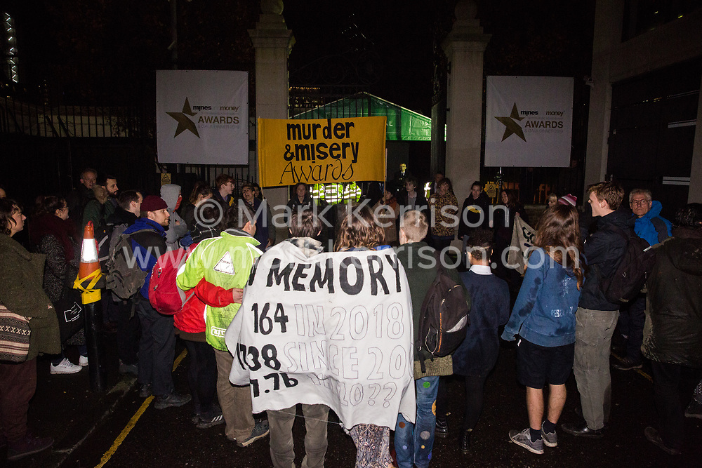 London, UK. 26 November, 2019. Activists from Global Justice Rebellion and London Mining Network hold a 'Murder & Misery Awards' protest outside the Mines and Money awards ceremony at the Honorary Artillery Company which is attended by mining company delegates, investors and government representatives. The activists were protesting to highlight the environmental impact of mining and the manner in which mining companies are increasingly attempting to 'greenwash' their activities by claiming that they are indispensable in a transition to sustainables.