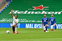 Football - 2019 / 2020 Championship - Play-off semi-final - 1st leg - Cardiff City vs Fulham<br /> <br /> Bobby Reid of Fulham takes the knee and gives a salute <br /> in a match played with no crowd due to Covid 19 coronavirus emergency regulations, in an almost empty ground, at the Cardiff City Stadium<br /> <br /> COLORSPORT/WINSTON BYNORTH