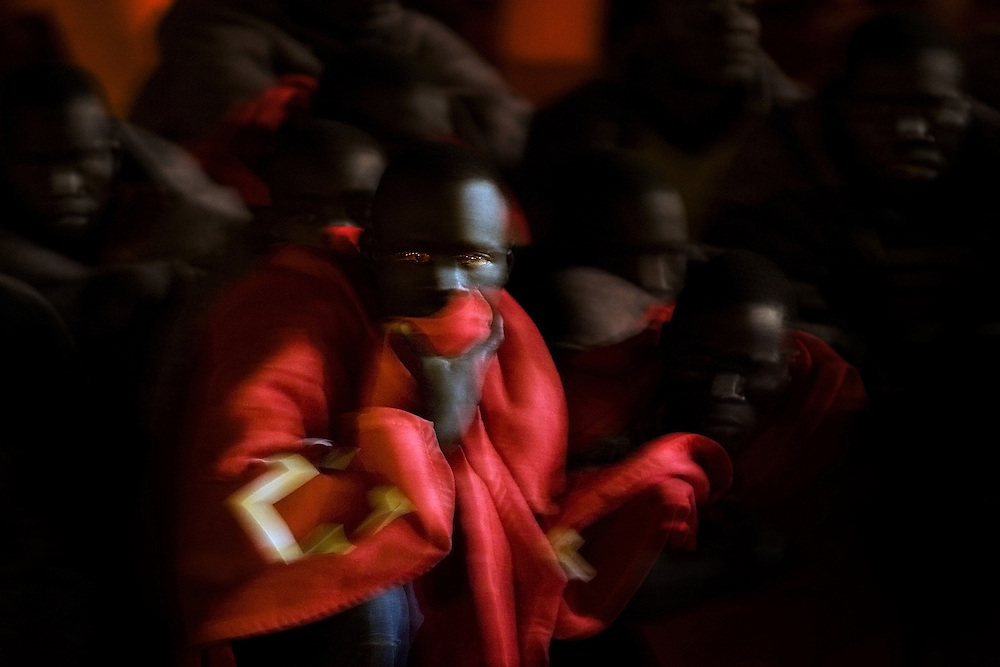 Some of 66 would be immigrants stand on board a coastguard patrol boat in the Port of Los Cristianos, on the Canary island of Tenerife, Spain, in this Sept. 3, 2007, file photo. The immigrants were rescued at sea off the island bringing the total to around 200 immigrants who were caught trying to enter Spain Monday in four different small boats.